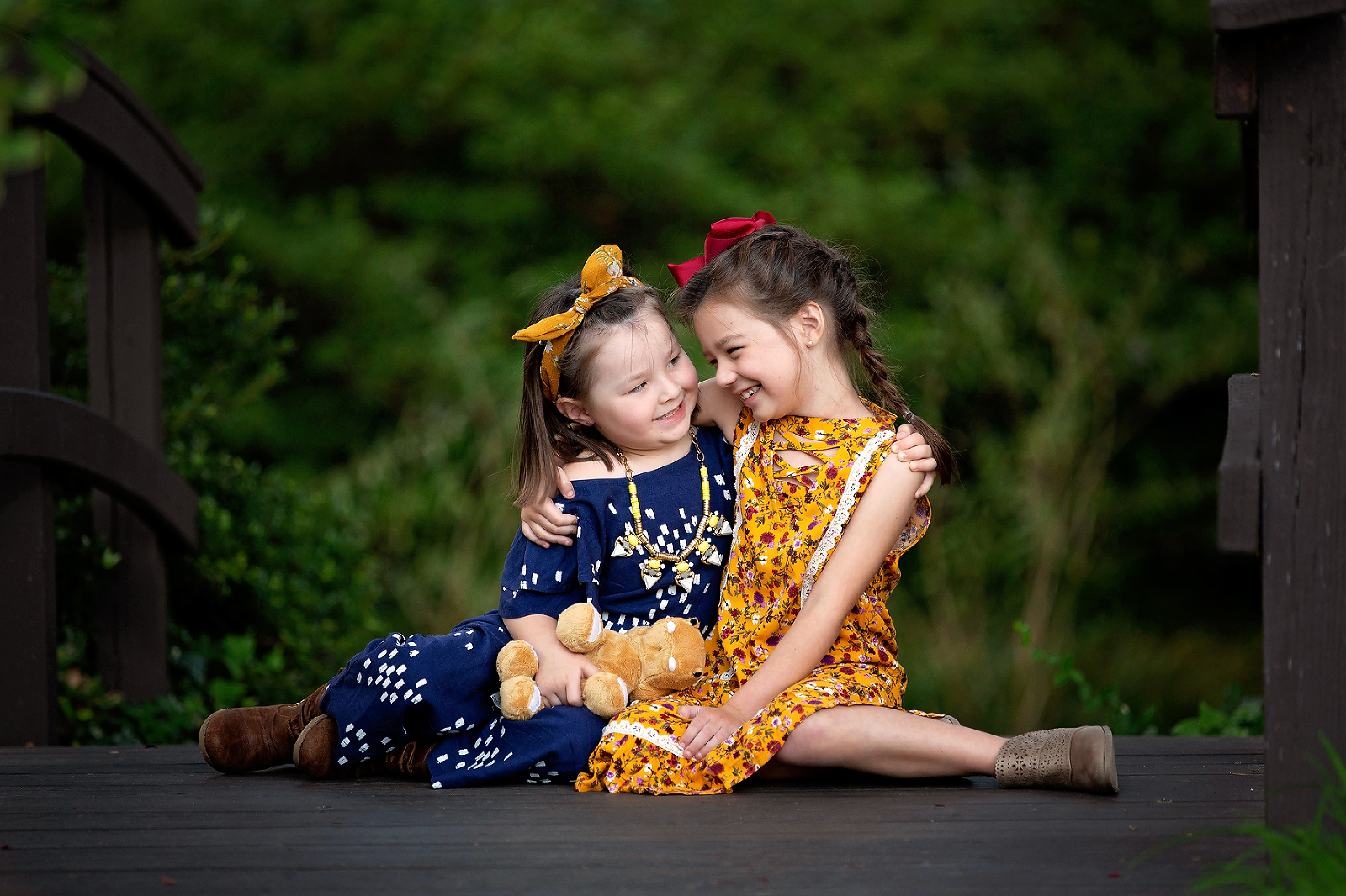 family photographer capturing siblings playing
