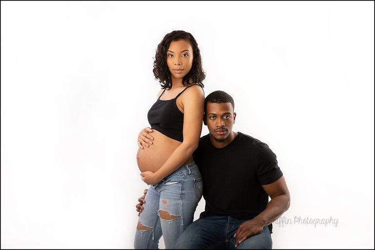 artistic model maternity portrait of black couple expecting
