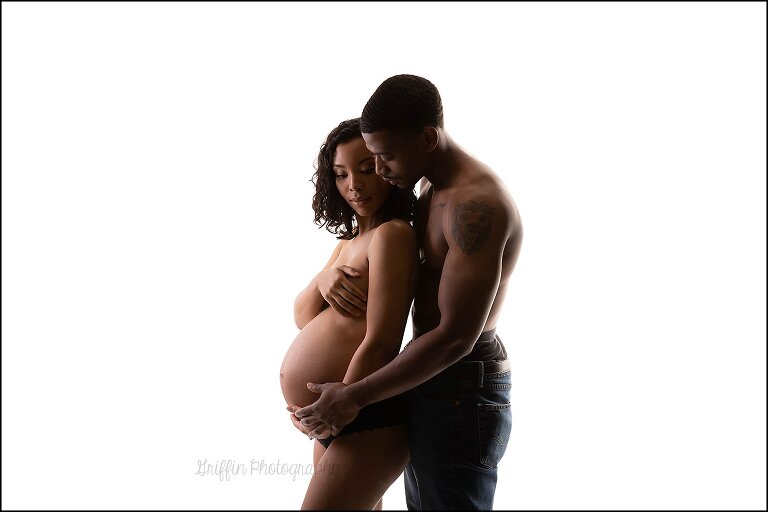 artistic nude style portrait of pregnant couple